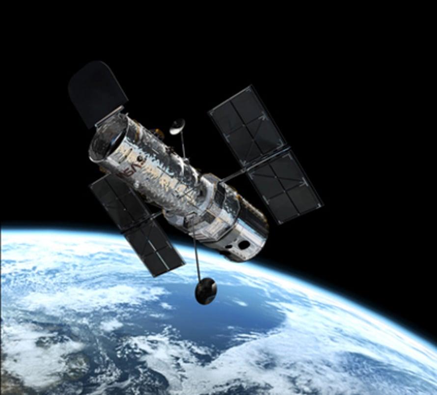 """Hubble Maata kiertävällä radalla. Kuva: <span class=""""photographer"""">Esa</span>"""