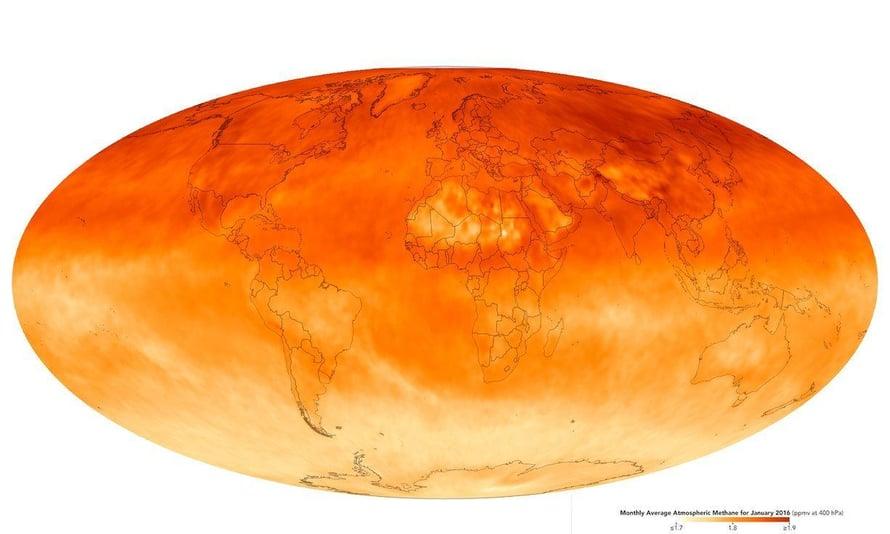 """Metaania on ilmakehässä enemmän pohjoisella pallonpuoliskolla. Mallissa suurempi pitoisuus näkyy punaisempana värinä. Kuva: <span class=""""photographer"""">Airs / Aqua / Nasa</span>"""