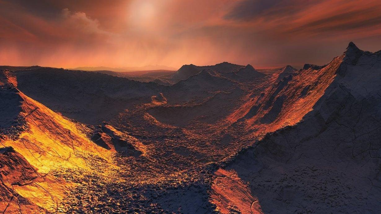 Löydetylle planeetalle luo valoa himmeä punainen kääpiötähti. Taiteilijan näkemys planeetan pinnanmuodoista. Kuva: M. Kornmesser / Eso