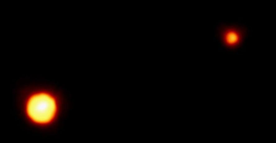 """Pluto ja sen kuu Kharon. Kuva: <span class=""""photographer"""">NASA</span>"""