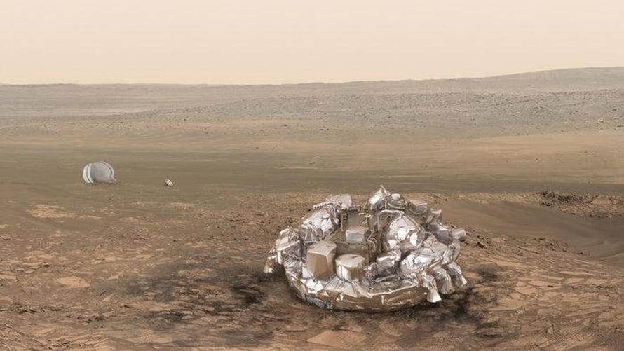 Taiteilijan näkemys Schiaparelli-laskeutujasta Marsin pinnalla.
